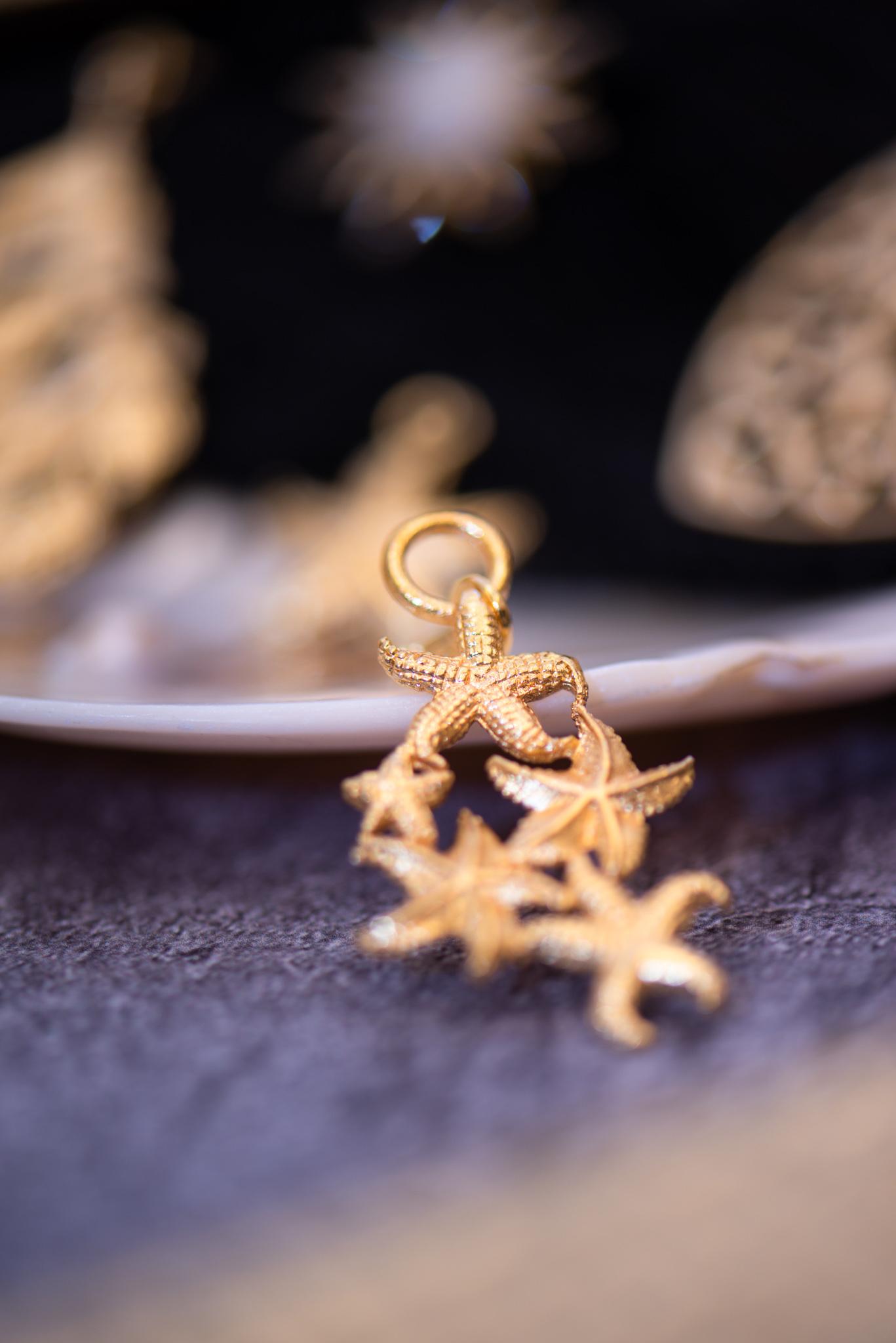 aranyozott öt tengericsillag medál